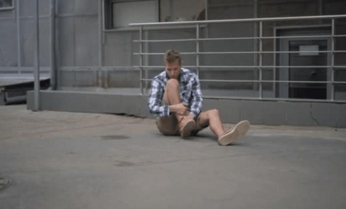 man falls on the street
